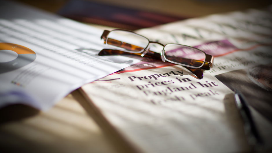 Glasses lying on financial papers