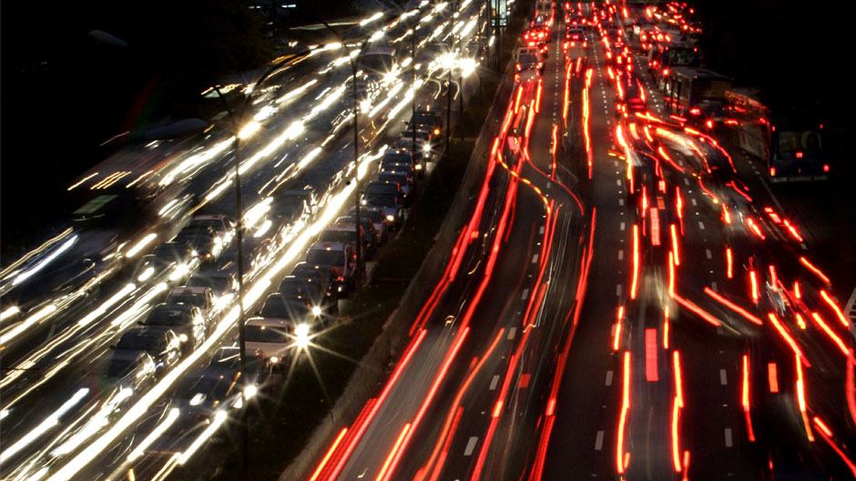 Vehicles crawl during traffic along a major road in Sao Paulo April 6, 2006.