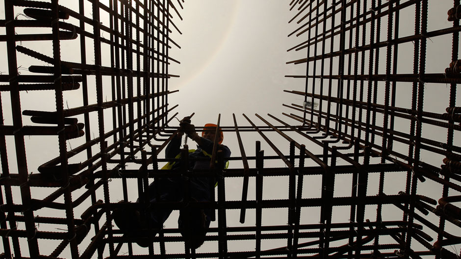 An employee works at a construction site of a Colombo port in Colombo February 13, 2013